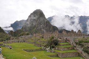 machu picchu ruins at mountain landscape, peru
