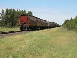 perspective of freight train on railway at summer