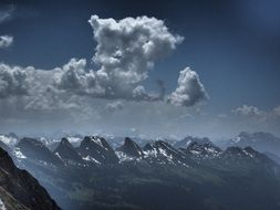 clouds over a mountain ridge in Switzerland