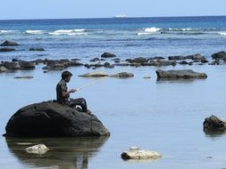 fisherman on a big stone in Litoral