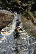 crossing the mountain bridge in Nepal