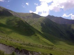 scenic green caucasus mountains beneath blue sky, south ossetia