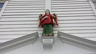 angel on the facade of a white building in norway
