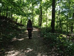 picture of the woman is in a forest