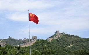 flag of China near the Great Wall of China