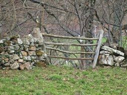 rustic wooden fence with stones scene