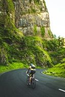cyclist on an asphalt road in the mountains