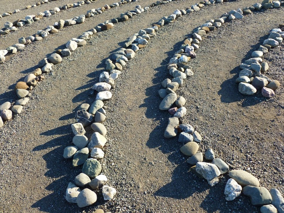 Stones laid out in a row for meditation.