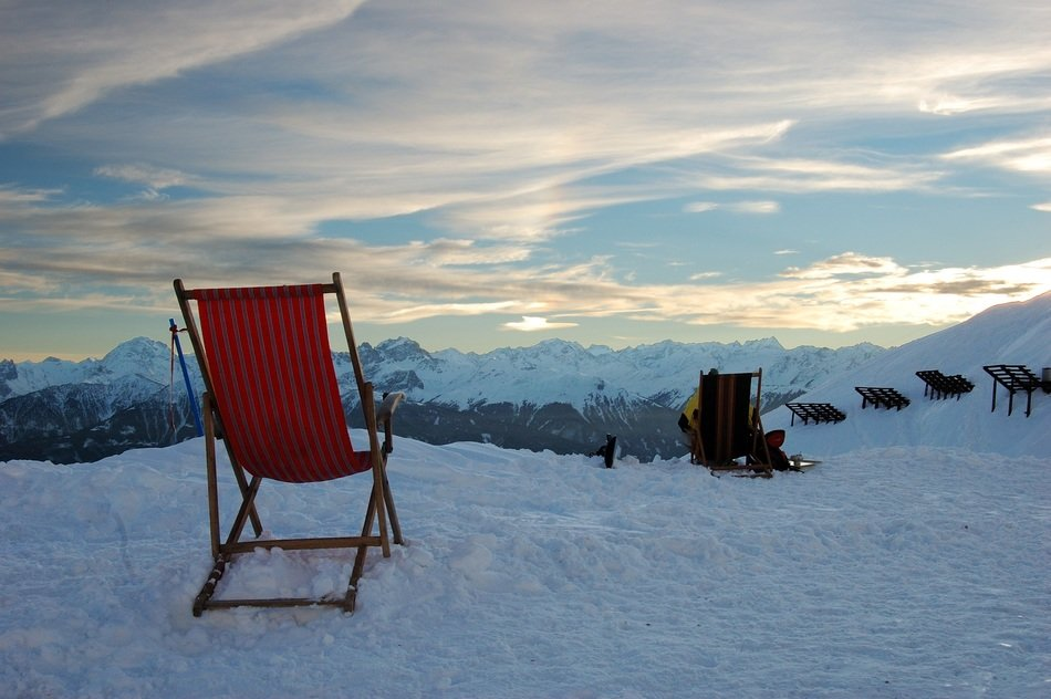 deck chairs on the background of a snowy landscape