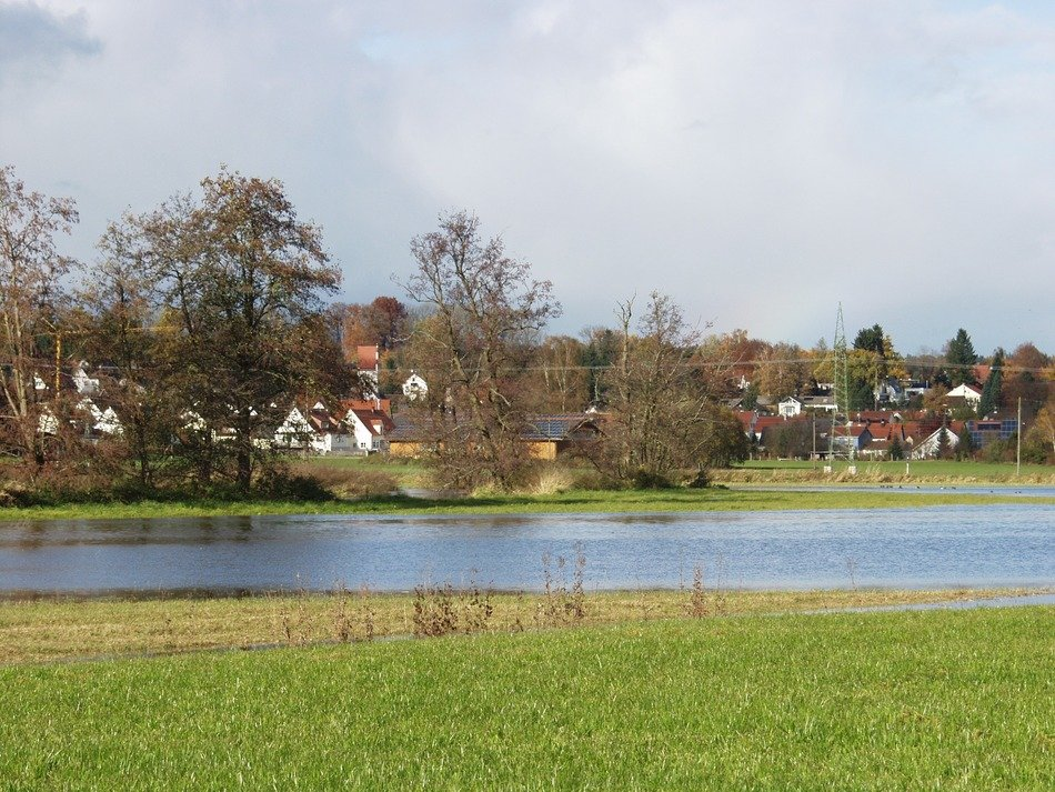 river flooding meadows in countryside