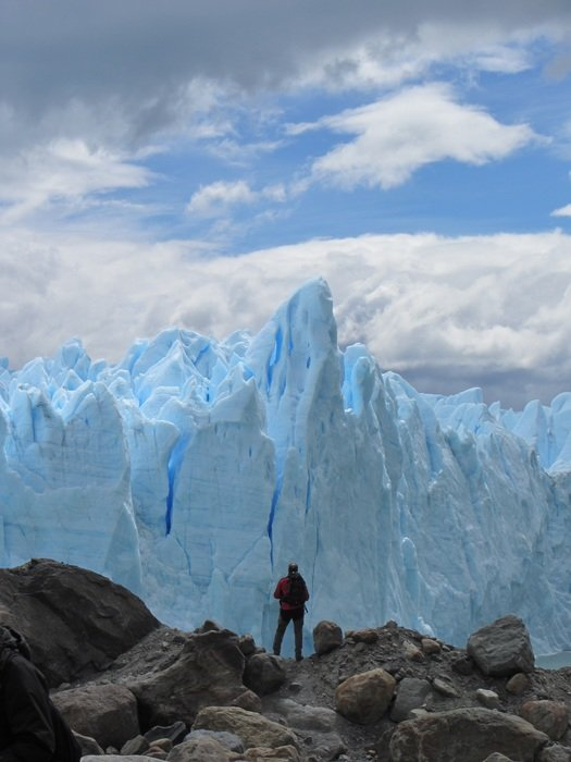 man stands on top of a glacier