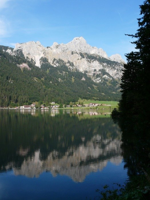 reflected in a lake of the Bavarian Alps