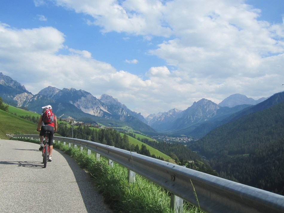 cyclists in Dolomites mountains Italy