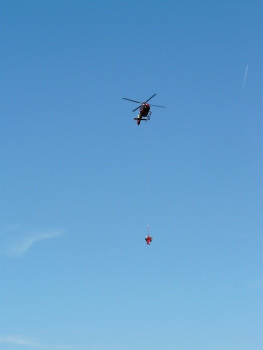 rescue helicopter in blue sky