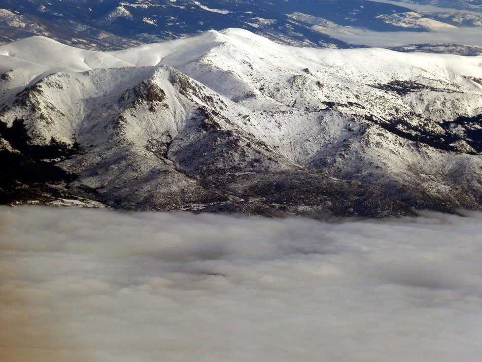 snow-capped mountains in the clouds