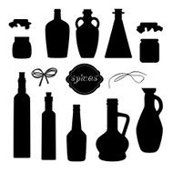 Set of different jars for spices and oil with ribbons