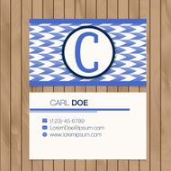 Business card with alphabet letter on a wood background N11