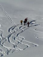 top view on the skiers in deep snow