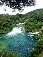 panoramic view of waterfalls among green trees in a national park, croatia, dalmatia