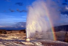 Landscape of yellowstone geyser and rainbow