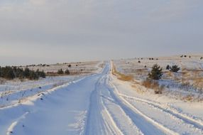 winter snowy road in the countryside