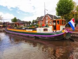 colorful boat on water in netherlands village
