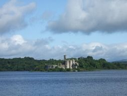 Distant view of a castle near a lake in ireland