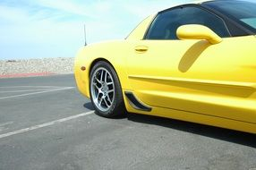 Side view of a yellow Corvette