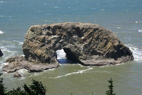 rock formation like an arch on the coast in oregon