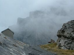 panorama of the swiss mountains in the clouds