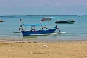 blue boat on the beach in bali