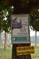 signs prohibiting poaching on rhinos in Nepal