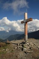 wooden cross on top of a mountain in Austria