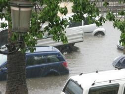flooded street wish cars, italy, calabria