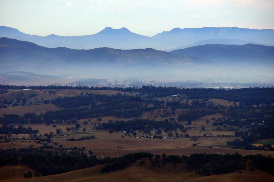 picturesque rural landscape on a background of mountains in the haze, Australia