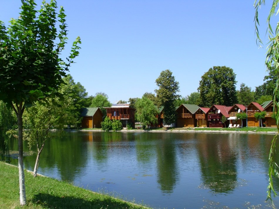 Wooden cottages on a lake bank