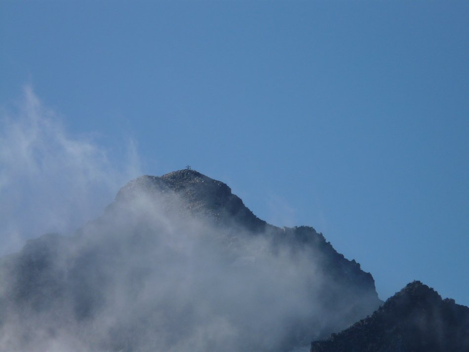 Pico Aneto in the haze on a background of blue sky