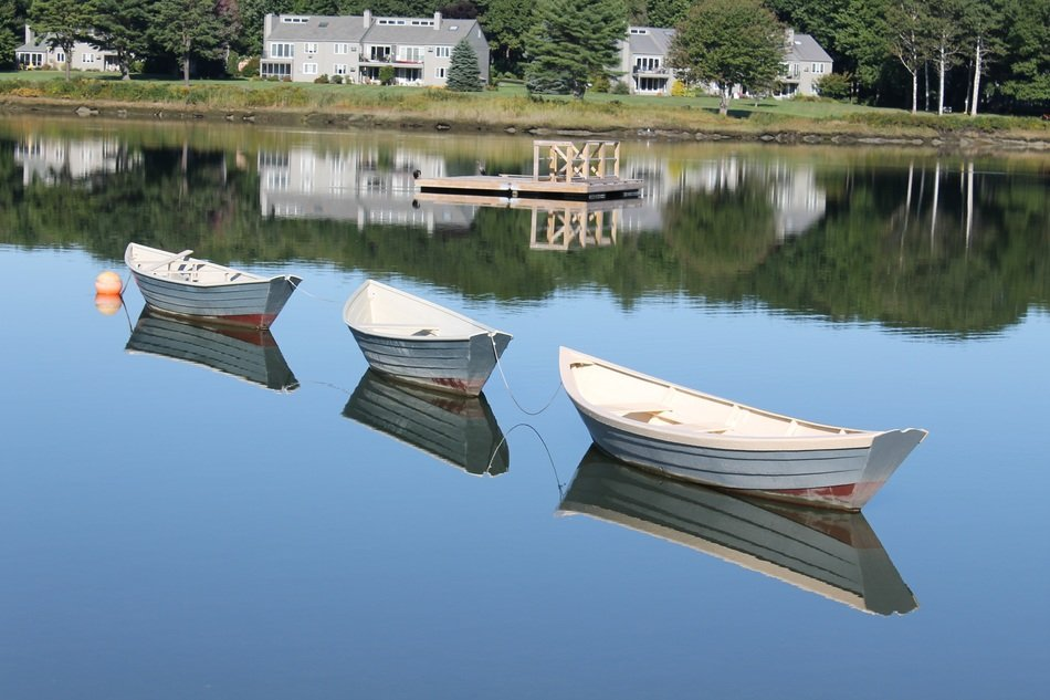 white boats in calm water