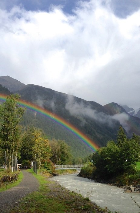 rainbow after rain in mountains