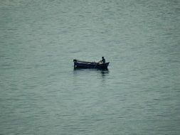 lonely man in a boat