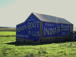 Barn with advertisement on a field in Australia