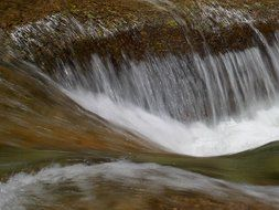 a strong flow of water