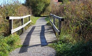 wooden bridge over a ditch in the countryside