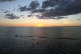 top view of a boat on the ocean at sunset