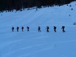 group of people in a ski tour in the evening