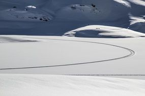 tracks on snow, winter mountain landscape
