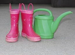 rubber boots and watering can