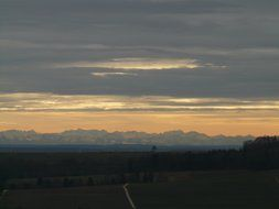 distant view of the Alpine mountains at dusk