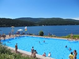 the view from the pool on the lake and the Black Forest