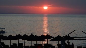 red setting sun over the coast of greece